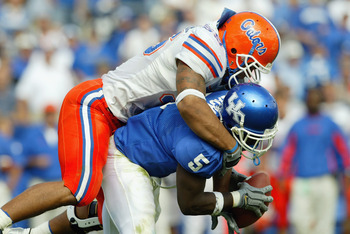 LEXINGTON,KY - SEPTEMBER 27:  Channing Crowder #55  of Florida tackles Arliss Beach #5 of Kentucky on September 27, 2003 at Commonwealth Stadium in Lexington, Kentucky. Florida won 24-21. (Photo by Andy Lyons/Getty Images)