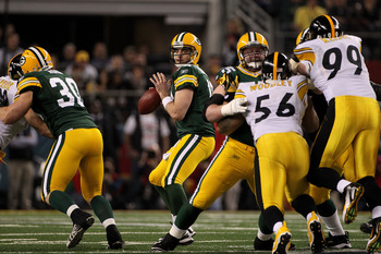 ARLINGTON, TX - FEBRUARY 06:  Aaron Rodgers #12 of the Green Bay Packers drops back against the Pittsburgh Steelers during the first quarter of Super Bowl XLV at Cowboys Stadium on February 6, 2011 in Arlington, Texas.  (Photo by Doug Pensinger/Getty Imag