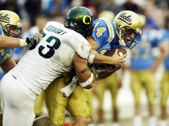 PASADENA, CA -NOVEMBER 15: Defensive end Igor Olshansky #53 of the Oregon Ducks sacks quarterback Drew Olson #14 of the UCLA Bruins on November 15, 2003 at the Rose Bowl in Pasadena, California.  (Photo by Stephen Dunn/Getty Images)