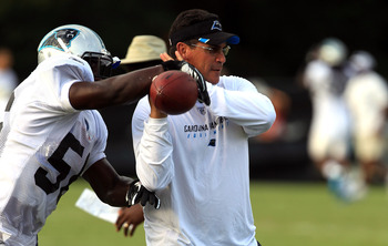 SPARTANBURG, SC - AUGUST 03:  Head coach Ron Rivera of the Carolina Panthers works with his new team during training camp at Wofford College on August 3, 2011 in Spartanburg, South Carolina.  (Photo by Streeter Lecka/Getty Images)
