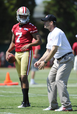 SANTA CLARA, CA - JULY 30: Head coach Jim Harbaugh of the San Francisco 49ers gives instructions to quarterback Colin Kaepernick #7 during practice at the San Francisco 49ers training facility on July 30, 2011 in Santa Clara, California. (Photo by Thearon