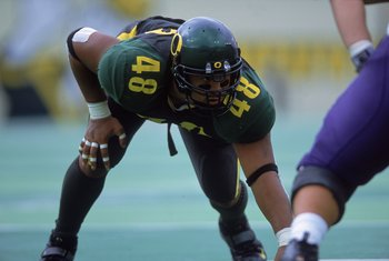 30 Sep 2000:  Saul Patu #48 of the Oregon Ducks is ready on the field during the game against the Washington Huskies at Autzen Stadium in Eugene, Oregon. The Ducks defeated thge Huskies 23-16.Mandatory Credit: Otto Greule Jr.  /Allsport