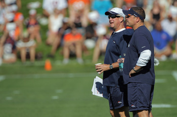 ENGLEWOOD, CO - JULY 28:  (L-R) Head coach John Fox of the Denver Broncos and Brian Xanders, General Manager, watch the team during training camp at the Paul D. Bowlen Memorial Broncos Centre at Dove Valley on July 28, 2011 in Englewood, Colorado.  (Photo