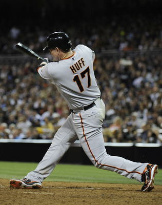 SAN DIEGO, CA - JULY 14: Aubrey Huff #17 of the San Francisco Giants hits a solo home run during the ninth inning of a baseball game against the San Diego Padres at Petco Park on July 14, 2011 in San Diego, California.  (Photo by Denis Poroy/Getty Images)