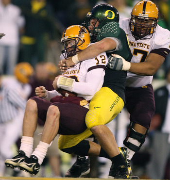 EUGENE, OR - NOVEMBER 03:  Quarterback Rudy Carpenter #12 of the Arizona State Sun Devils is sacked by Nick Reed #49 of the Oregon Ducks at Autzen Stadium on November 3, 2007 in Eugene, Oregon. The Ducks defeated the Sun Devils 35-23. (Photo by Otto Greul