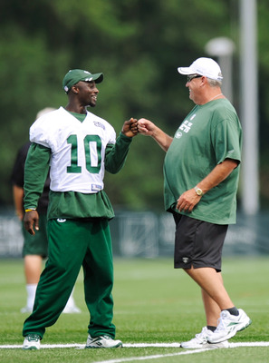 FLORHAM PARK, NJ - AUGUST 07:  Santonio Holmes #10 of the New York Jets speaks with head coach Rex Ryan at NY Jets Practice Facility on August 7, 2011 in Florham Park, New Jersey.  (Photo by Patrick McDermott/Getty Images)