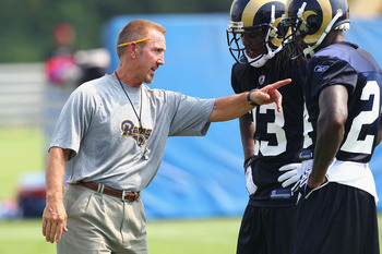 EARTH CITY, MO - JULY 31:  Head coach Steve Spagnuolo of the St. Louis Rams instructs teammates Jerome Murphy #23 and Ron Bartell #24 during training camp at the Russell Training Center on July 31, 2011 in Earth City, Missouri.  (Photo by Dilip Vishwanat/