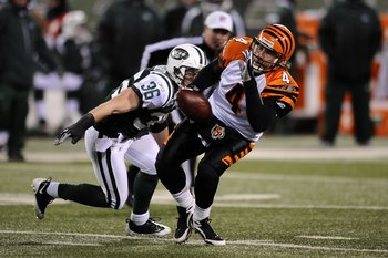 EAST RUTHERFORD, NJ - JANUARY 03:  Jim Leonhard #36 of the New York Jets tackles quarterback J.T. O'Sullivan #4 of the Cincinnati Bengals in the second half of the game at Giants Stadium on January 3, 2010 in East Rutherford, New Jersey.  The Jets defeate