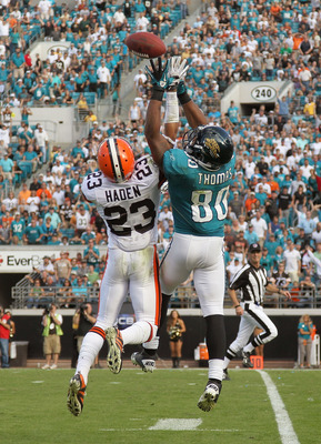 JACKSONVILLE, FL - NOVEMBER 21: Mike Thomas #80 of the Jacksonville Jaguars goes up for a ball against Joe Haden #23 during a game agaisnt the Cleveland Browns at EverBank Field on November 21, 2010 in Jacksonville, Florida.  (Photo by Mike Ehrmann/Getty