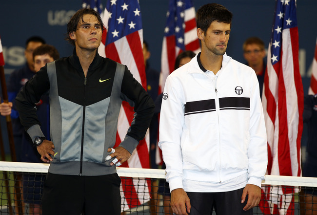 NEW YORK - SEPTEMBER 13:  Rafael Nadal of Spain (L) and runner up Novak Djokovic of Serbia (R) look on during the trophy ceremony after their men's singles final on day fifteen of the 2010 U.S. Open at the USTA Billie Jean King National Tennis Center on S