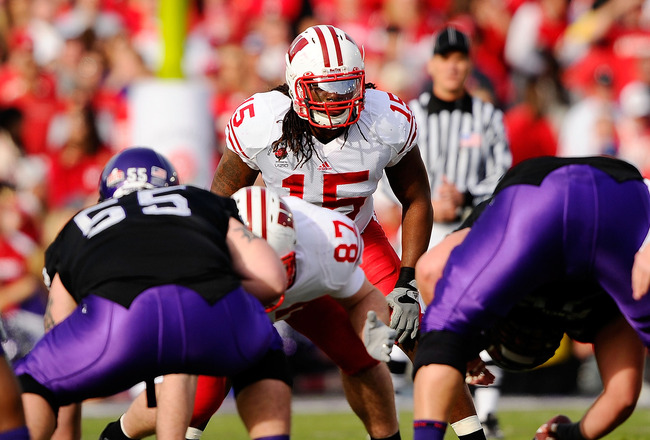 PASADENA, CA - JANUARY 01:  Linebacker Culmer St. Jean #15 of the Wisconsin Badgers lines up against the TCU Horned Frogs during the 97th Rose Bowl game on January 1, 2011 in Pasadena, California.  (Photo by Kevork Djansezian/Getty Images)