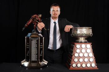 Daniel Sedin with the Art Ross and Ted Lindsay Award in 2011.