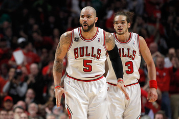 CHICAGO, IL - MAY 15:  Carlos Boozer #5 and Joakim Noah #13 of the Chicago Bulls react against the Miami Heat in Game One of the Eastern Conference Finals during the 2011 NBA Playoffs on May 15, 2011 at the United Center in Chicago, Illinois. NOTE TO USER