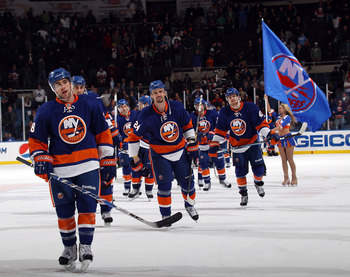 UNIONDALE, NY - MARCH 08:  The New York Islanders celebrate their 4-3 victory over the Toronto Maple Leafs at the Nassau Coliseum on March 8, 2011 in Uniondale, New York. The Islanders defeated the Maple Leafs 4-3 in overtime. (Photo by Bruce Bennett/Gett
