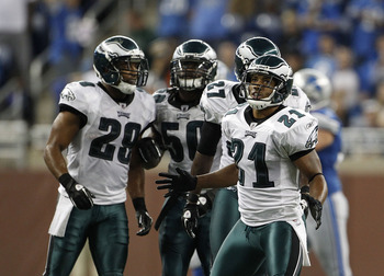 DETROIT - SEPTEMBER 19: Joselio Hanson #21 and Nate Allen #29 of the Philadelphia Eagles celebrates after stoping the Detroit Lions on a fourth down play late in the game at Ford Field on September 19, 2010 in Detroit, Michigan. The Eagles defeated the Li