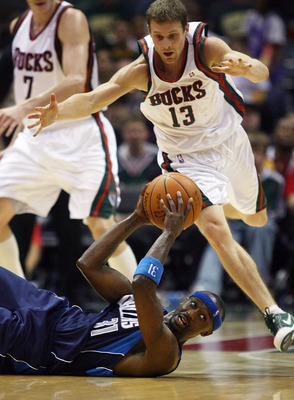 MILWAUKEE - NOVEMBER 16: Jason Terry #31 of the Dallas Mavericks looks for a teammate to pass to after slipping on the floor as Luke Ridnour #13 of the Milwaukee Bucks closes in at the Bradley Center on November 16, 2009 in Milwaukee, Wisconsin. The Maver