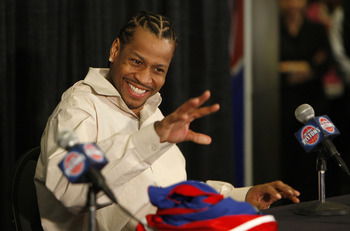 AUBURN HILLS, MI - NOVEMBER 04:  Allen Iverson #1 of the Detroit Pistons waves to one of his children prior to a press conference after being traded from the Denver Nuggets on November 4, 2008 at the Palace of Auburn Hills in Auburn Hills, Michigan. NOTE