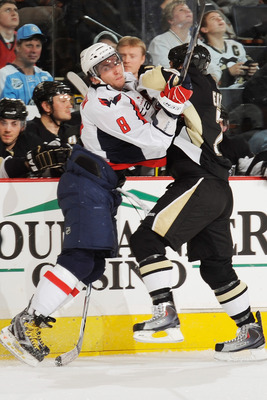 PITTSBURGH - JANUARY 21:  Forward Alex Ovechkin #8 of the Washington Capitals checks defenseman Mark Eaton #7 of the Pittsburgh Penguins on January 21, 2010 at Mellon Arena in Pittsburgh, Pennsylvania.  (Photo by Jamie Sabau/Getty Images)