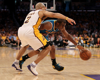 LOS ANGELES, CA - APRIL 17:  Chris Paul #3 of  the New Orleans Hornets drives against Derek Fisher #2 of the Los Angeles Lakers in Game One of the Western Conference Quarterfinals in the 2011 NBA Playoffs on April 17, 2011 at Staples Center in Los Angeles