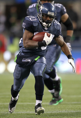 SEATTLE, WA - JANUARY 02:  Running back Justin Forsett #20 of the Seattle Seahawks rushes with the ball against the St. Louis Rams during their game at Qwest Field on January 2, 2011 in Seattle, Washington.  (Photo by Otto Greule Jr/Getty Images)