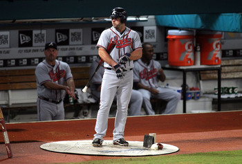 MIAMI GARDENS, FL - AUGUST 09:  Dan Uggla #29  of the Atlanta Braves prepares to bat against the Florida Marlins at Sun Life Stadium on August 9, 2011 in Miami Gardens, Florida.  (Photo by Marc Serota/Getty Images)