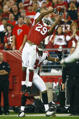 GLENDALE, AZ - JANUARY 03:  Dominique Rodgers-Cromartie #29 of the Arizona Cardinals makes a leaping interception over Roddy White #84 of the Atlanta Falcons during the NFC Wild Card Game on January 3, 2009 at University of Phoenix Stadium in Glendale, Ar