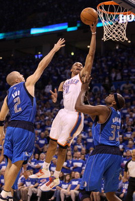 OKLAHOMA CITY, OK - MAY 21:  Russell Westbrook #0 of the Oklahoma City Thunder shoots the ball between Jason Kidd #2 and Brendan Haywood #33 of the Dallas Mavericks in the fourth quarter in Game Three of the Western Conference Finals during the 2011 NBA P