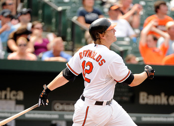 BALTIMORE, MD - AUGUST 07:  Mark Reynolds #12 the Baltimore Orioles hits a home run in the seventh inning against the Toronto Blue Jays at Oriole Park at Camden Yards on August 7, 2011 in Baltimore, Maryland.  (Photo by Greg Fiume/Getty Images)