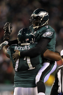 PHILADELPHIA, PA - JANUARY 09:  Michael Vick #7 of the Philadelphia Eagles celebrates with Jason Peters #71 after a touchdown in the thrid quarter against the Green Bay Packers during the 2011 NFC wild card playoff game at Lincoln Financial Field on Janua