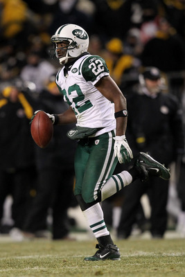 PITTSBURGH, PA - JANUARY 23:  Brodney Pool #22 of the New York Jets runs down field after intercepting a pass intended for Emmanuel Sanders #88 of the Pittsburgh Steelers in the third quarter of the 2011 AFC Championship game at Heinz Field on January 23,