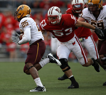MADISON, WI - SEPTEMBER 18: Mike Taylor #53 of the Wisconsin Badgers closes in on Deantre Lewis #25 of the Arizona State Sun Devils at Camp Randall Stadium on September 18, 2010 in Madison, Wisconsin. Wisconsin defeated Arizona State 20-19. (Photo by Jona