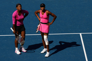 NEW YORK - SEPTEMBER 14:  Venus Williams (R) and Serena Williams look at the replay of a disputed call during the Women's Doubles final against Cara Black of Zimbabwe and Liezel Huber on day fifteen of the 2009 U.S. Open at the USTA Billie Jean King Natio