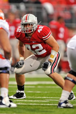 COLUMBUS, OH - SEPTEMBER 26: Linebacker Andrew Sweat #42 of the Ohio State Buckeyes waits for the snap against the Illinois Fighting Illini at Ohio Stadium on September 26, 2009 in Columbus, Ohio.  (Photo by Jamie Sabau/Getty Images)