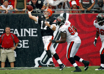 TAMPA, FL - SEPTEMBER 12:  Quarterback Jake Delhomme #17 of the Cleveland Browns throws a pass as defensive tackle Brian Price #92 of the Tampa Bay Buccaneers closes in during the game at Raymond James Stadium on September 12, 2010 in Tampa, Florida.  (Ph