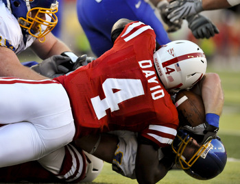 LINCOLN, NEBRASKA - SEPTEMBER 25: Nebraska Cornhuskers linebacker Lavonte David #4 tackles South Dakota State Jackrabbits running back Kyle Minett #30 during first half action of their game at Memorial Stadium on September 25, 2010 in Lincoln, Nebraska. N