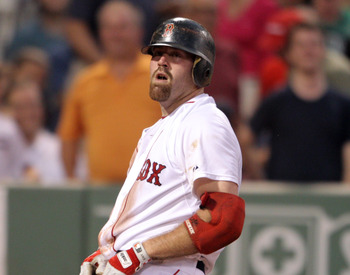 BOSTON, MA - AUGUST 01:  Kevin Youkilis #20 of the Boston Red Sox reacts after he is called out at home in the third inning against the Cleveland Indians on August 1, 2011 at Fenway Park in Boston, Massachusetts.  (Photo by Elsa/Getty Images)