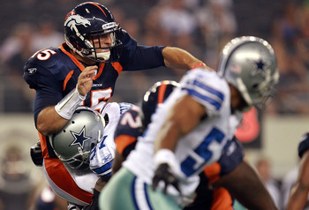 ARLINGTON, TX - AUGUST 11:  Tim Tebow #15 of the Denver Broncos is sacked by Jason Hatcher #97 of the Dallas Cowboys during a preseason game at Cowboys Stadium on August 11, 2011 in Arlington, Texas.  (Photo by Ronald Martinez/Getty Images)