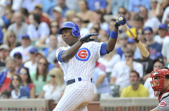 CHICAGO, IL - AUGUST 06:  Alfonso Soriano #12 of the Chicago Cubs follows through on an RBI double scoring Reed Johnson during the fourth inning against the Cincinnati Reds at Wrigley Field on August 6, 2011 in Chicago, Illinois.  (Photo by Brian Kersey/G