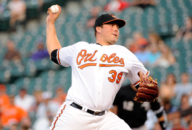BALTIMORE, MD - AUGUST 10:  Tommy Hunter #39 of the Baltimore Orioles pitches against the Chicago White Sox at Orioles Park at Camden Yards on August 10, 2011 in Baltimore, Maryland.  (Photo by Greg Fiume/Getty Images)