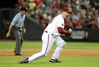 PHOENIX, AZ - AUGUST 09:  Relief pitcher J.J. Putz #40 of the Arizona Diamondbacks celebrates after defeating the Houston Astros in the Major League Baseball game at Chase Field on August 9, 2011 in Phoenix, Arizona. The Diamondbacks defeated the Astros 1