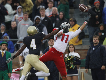 SOUTH BEND, IN - NOVEMBER 13: Gary Gray #4 of the Notre Dame Fighting Irish gets his hand in the face of Luke Matthews #11 of the Utah Utes at Notre Dame Stadium forcing an incomplete pass on November 13, 2010 in South Bend, Indiana. (Photo by Jonathan Da
