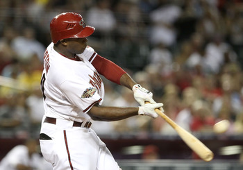 PHOENIX, AZ - AUGUST 09:  Justin Upton #10 of the Arizona Diamondbacks hits a two run home run against the Houston Astros during the sixth inning of the Major League Baseball game at Chase Field on August 9, 2011 in Phoenix, Arizona.  (Photo by Christian