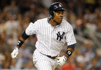 NEW YORK, NY - AUGUST 10:  Curtis Granderson #14 of the New York Yankees watches his second homerun of the game against the Los Angeles Angels of Anaheim on August 10, 2011 at Yankee Stadium in the Bronx borough of New York City.  (Photo by Mike Stobe/Get