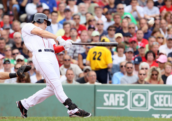 BOSTON, MA - AUGUST 06:  Jacoby Ellsbury #2 of the Boston Red Sox hits a three run homer in the fourth inning against the New York Yankees on August 6, 2011 at Fenway Park in Boston, Massachusetts.  (Photo by Elsa/Getty Images)