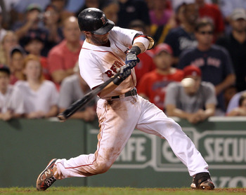 BOSTON, MA - AUGUST 07:  Dustin Pedroia #15 of the Boston Red Sox hits a SAC fly in the bottom of the ninth inning to score Marco Scutaro to tie the game against the New York Yankees on August 7, 2011 at Fenway Park in Boston, Massachusetts.  (Photo by El