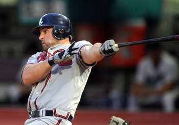 MIAMI GARDENS, FL - AUGUST 10:  Dan Uggla #26 of the Atlanta Braves hits an RBI single in the second  inning against the Florida Marlins at Sun Life Stadium on August 10, 2011 in Miami Gardens, Florida.  (Photo by Marc Serota/Getty Images)