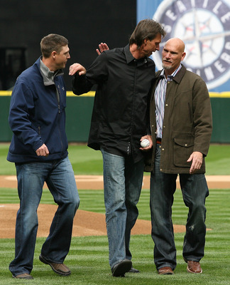 SEATTLE - APRIL 12:  L to R former Mariners stars Dan Wilson, Randy Johnson, and Jay Buhner greet each other pitch prior to the Mariners' home opener against the Oakland Athletics at Safeco Field on April 12, 2010 in Seattle, Washington. (Photo by Otto Gr