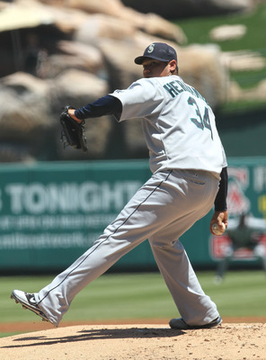 ANAHEIM, CA - AUGUST 07:  Felix Hernandez #34 of the Seattle Mariners throws a pitch against the Los Angeles Angels of Anaheim on August 7, 2011 at Angel Stadium in Anaheim, California.  (Photo by Stephen Dunn/Getty Images)