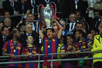 LONDON, ENGLAND - MAY 28:  Ibrahim Afellay of FC Barcelona (C) lifts the trophy in celebration after victory in the UEFA Champions League final between FC Barcelona and Manchester United FC at Wembley Stadium on May 28, 2011 in London, England.  (Photo by