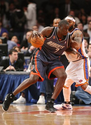 NEW YORK - MARCH 07: DeSagana Diop #7 of the Charlotte Bobcats dribbles the ball against the New York Knicks on March 7, 2009 at Madison Square Garden in New York City. NOTE TO USER: User expressly acknowledges and agrees that, by downloading and or using